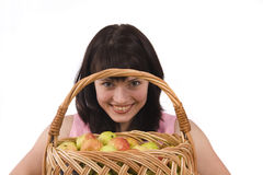Girl with a basket of apples. Royalty Free Stock Photos