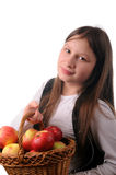 Girl with basket of apples Royalty Free Stock Image