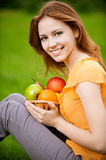 Girl with basket apples Stock Photos