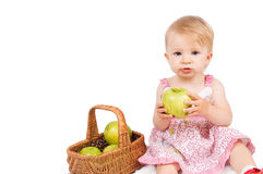 Girl with basket and apples Royalty Free Stock Photos