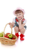 Girl with basket of apples Royalty Free Stock Photography