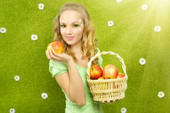 Girl with basket of apples Royalty Free Stock Images