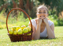 Girl with a basket of apples outdoor Stock Photos