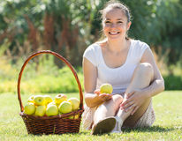 Girl with a basket of apples outdoor Stock Photo