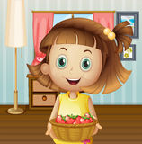 A girl with a basket of berries inside the house Stock Images
