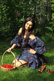 Girl with a basket of cherries Royalty Free Stock Image