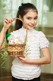Girl with a basket of Easter eggs Royalty Free Stock Photo