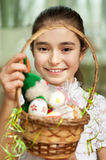 Girl with a basket of Easter eggs Stock Image