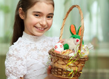 Girl with a basket of Easter eggs Stock Photos