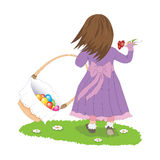 Easter egg hunt. Girl with basket of easter eggs Royalty Free Stock Photography