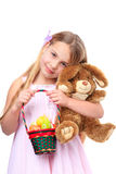 Girl with basket of easter eggs and easter bunny Stock Photos
