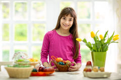 Girl with basket of Easter eggs Stock Photo