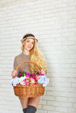 Girl with a basket of flowers Royalty Free Stock Images
