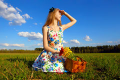 Girl with a basket of flowers in dreams. Stock Photo