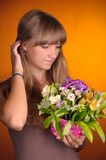 Girl with a basket of flowers. Straightens hair Stock Photo