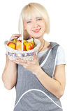 Girl with a basket of fruit Stock Images