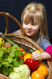 Girl with basket of fruit and vegetables Stock Image