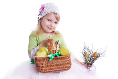 Girl with basket full of apples and some flowers. Smiling girl with basket full of apples and some flowers on white Royalty Free Stock Image
