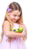 Girl with a basket full of easter eggs Royalty Free Stock Image