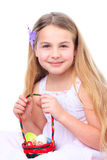 Girl with a basket full of easter eggs smiling Royalty Free Stock Photo