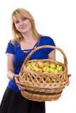 Girl with a basket full of fruits Royalty Free Stock Photos