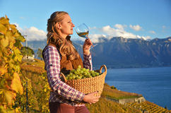 Girl with a basket full of grapes Royalty Free Stock Photography
