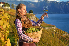 Girl with a basket full of grapes Stock Photos