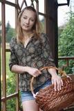 Girl with basket in garden Stock Image