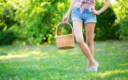 Girl with basket going to have a picnic Stock Photo