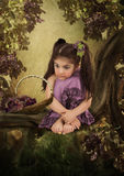 The girl with basket of grapes Royalty Free Stock Image
