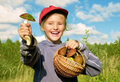 Girl with basket mushrooms Royalty Free Stock Photography