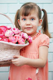Girl with a basket of roses Stock Photography