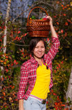 Girl with basket of vegetables Royalty Free Stock Photo