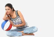 Girl with a basketball Stock Image