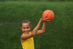 Girl with basketball Stock Images