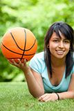 Girl with a basketball Stock Photos