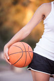 Girl with a basketball ball Royalty Free Stock Image
