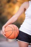 Girl with a basketball ball Royalty Free Stock Image