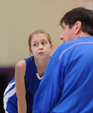 Girl in basketball huddle Royalty Free Stock Photo