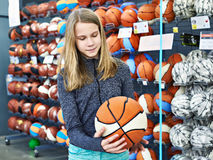 Girl with basketball in sport store Stock Photo