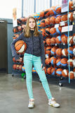 Girl with basketball in sport store Stock Images