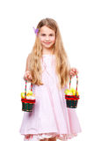 Girl with baskets full of easter eggs Stock Photography