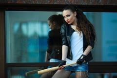 Girl with a bat Stock Photos