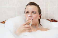 Girl in a bath. Drinking wine Stock Photos