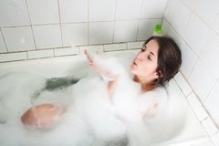 Girl in a bath Royalty Free Stock Image