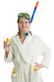 Girl in bath robe. Young girl in bath robe with diving equipment and ducks. Isolated over white Royalty Free Stock Image