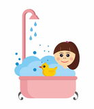 Girl in a bath with rubber duck Stock Photo
