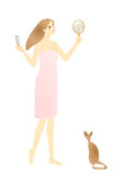 Girl in bath towel brushing hair with a cat Royalty Free Stock Images