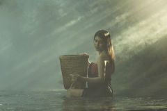 The girl bathed in a the creek. Stock Photos