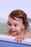 A girl bathes. Royalty Free Stock Image